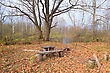 Aging Bench In Autumn Park stock photo