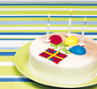 lit cake candle birthdays striped celebration stock photo
