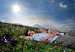 affection grass relax hugging young people stock photography