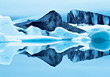 Frozen water icebergs blue backgrounds reflections rock stock image