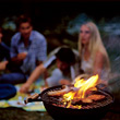 People Eating  flames grill chatting people fire sausages stock photo