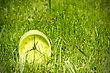 Alarm Clock In Grass On The Morning Of A Bright Sunny Day