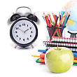 Students Alarm Clock, Notebook Stack And Pencils. Schoolchild And Student Studies Accessories. Back To School Concept stock photo