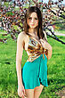 Alluring Lady Wearing Golden And Turquoise Dress Posing In The Garden