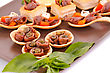 Appetizers Anchovies In Pastries, Basil On Brown Plate stock photo
