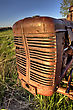 Antique Farm Equipment Sunset Saskatchewan Canada stock image
