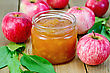 Apple Jam In A Glass Jar, Fresh Red Apples, Twigs With Leaves On A Wooden Board