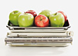 Apples On Kitchen Scale stock photography
