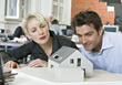 Architects Working On House Model stock photography