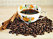 Arrangement Of Coffee And Cinnamon Sticks With Vintage Coffee Cup stock photography