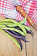 Asparagus Beans Green And Purple, Napkin, Knife On Background Wooden Plank