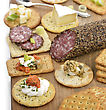 Assorted Crackers With Salami ,Cheese And Dips stock image