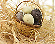 Assortment Of Chocolate Eggs In A Basket, Close Up stock photography