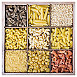 Italy Assortment Of Italian Pasta In A Wooden Box On A White Background stock image