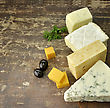 Brie Assortment Of Cheese On A Cutting Board stock photography