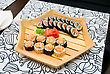At Restaurant: Set Of Sushi On Wood Plate