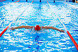 Athletic Man Swimming In The Pool stock photo