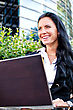 Attractive Businesswoman With Notebook In City Park