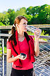 Attractive Woman Drinking Water On The Bridge stock image
