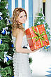 Attractive Young Woman With A Christmas Present In The Orange Box