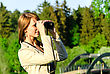 Attractive Young Woman Looking Through Binoculars stock photo