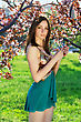 Attractive Young Woman Wearing Frank Dress Posing In The Garden