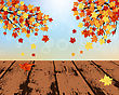Autumn Frame With Maple Leaves And Grunge Wooden Table In Perspective