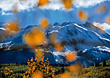 Autumn Leaves Falling Over Mountains stock photo