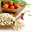 Baby Lima Beans , Tomatoes And Spices In Wooden Bowls stock photography