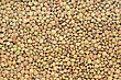 Background Of Brown Small Dry Raw Lentils