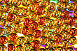Background Of Glowing Gold And Orange Balls With Festive Lights Behind, Christmas, Holiday Or Party Theme. stock photo