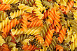 Background Of Raw Dry Spiral Tricolor Pasta stock photo