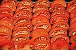 Background Of Wedges Of Fresh Tomato Set Out In Rows stock photography
