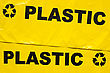 Background Of Yellow Garbage Bags For Recyclable Plastic