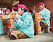 BALI, INDONESIA - APRIL 01: Musicians In The Gamelan Troupe Play Traditional Balinese Music To Accompany Dancers In A 'Barong Dance Show' In Ubud Village On April 01, 2011 In Bali, Indonesia stock photo