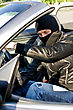 Breaking Bandit In Mask Stealing A Car. stock photo
