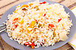 Basmati Rie Cooked With Colorful Peppers On Gray Plate stock photo