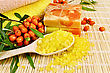 Bath Salt And Yellow And Two Bars Of Homemade Soap, Twigs And Berries Of Sea Buckthorn Amid Bamboo Napkin stock image