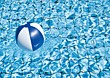 Beach Ball Floating In Swimming Pool stock photo