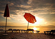 Beach Chairs & Umbrellas At Sunset stock photo