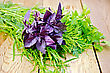 Beam Of Purple Basil, Parsley, Tarragon And Dill On A Wooden Boards Background stock image