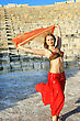 Performance Beautiful Belly Dancer On The Ancient Stairs Of Kurion Amphitheatre In Cyprus stock photo
