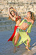 Beautiful Belly Dancers In The Ancient Kourion Amphitheatre In Cyprus stock photo