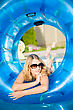Beautiful Blond Woman Posing With Rubber Ring In Swimming Pool