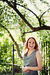 Beautiful Laughing Young Woman In The Park. Summer, Wind. Freedom. Blonde Hair. Soft Focus. Small Amount Of Grain Added For Best Final Impression stock photo