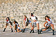 Beautiful Modern Dancers On The Ancient Stairs Of Kourion Amphitheatre In Cyprus stock photography