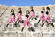 Beautiful Modern Dancers On The Ancient Stairs Of Kurion Amphitheatre In Cyprus stock photo