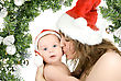 Beautiful Mommy Santa And Her Baby Santa Boy On A White