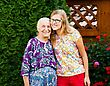 Beautiful Teenager Granddaughter Visiting Kind Grandmother At The Nursing Home stock photography
