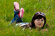 Beautiful Woman Lying On Green Grass